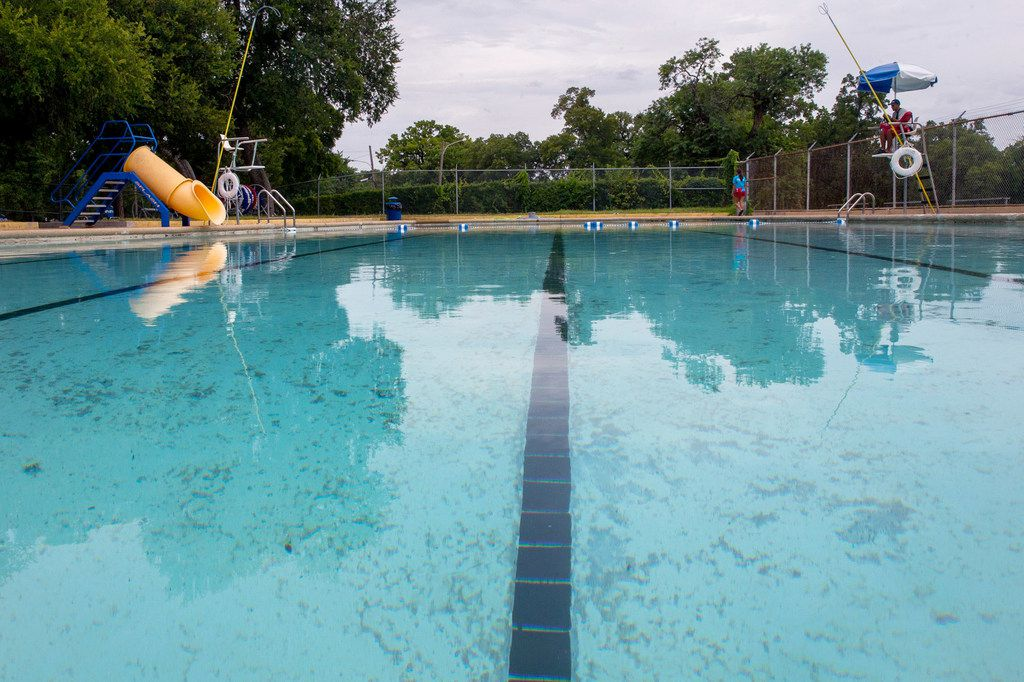 Lifeguard Joshua Acosta, 17, looked over an empty Glendale swimming pool last month in East Oak Cliff, a neighborhood of mostly black and Latino residents.