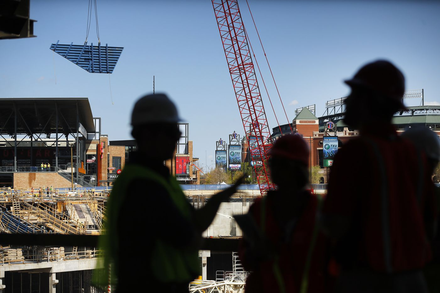 A large piece of decking is moved by a crane during a press event at the new Globe Life Field under construction in Arlington, Texas, Tuesday, September 18, 2018. The Texas Rangers and Manhattan Construction celebrated the One Million Man Hours by providing a barbecue lunch for it's nearly 900 construction workers. (Tom Fox/The Dallas Morning News)
