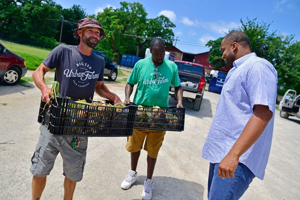 Demler and Horton deliver freshly picked onions to Donald Wesson, program director of Cornerstone in South Dallas.