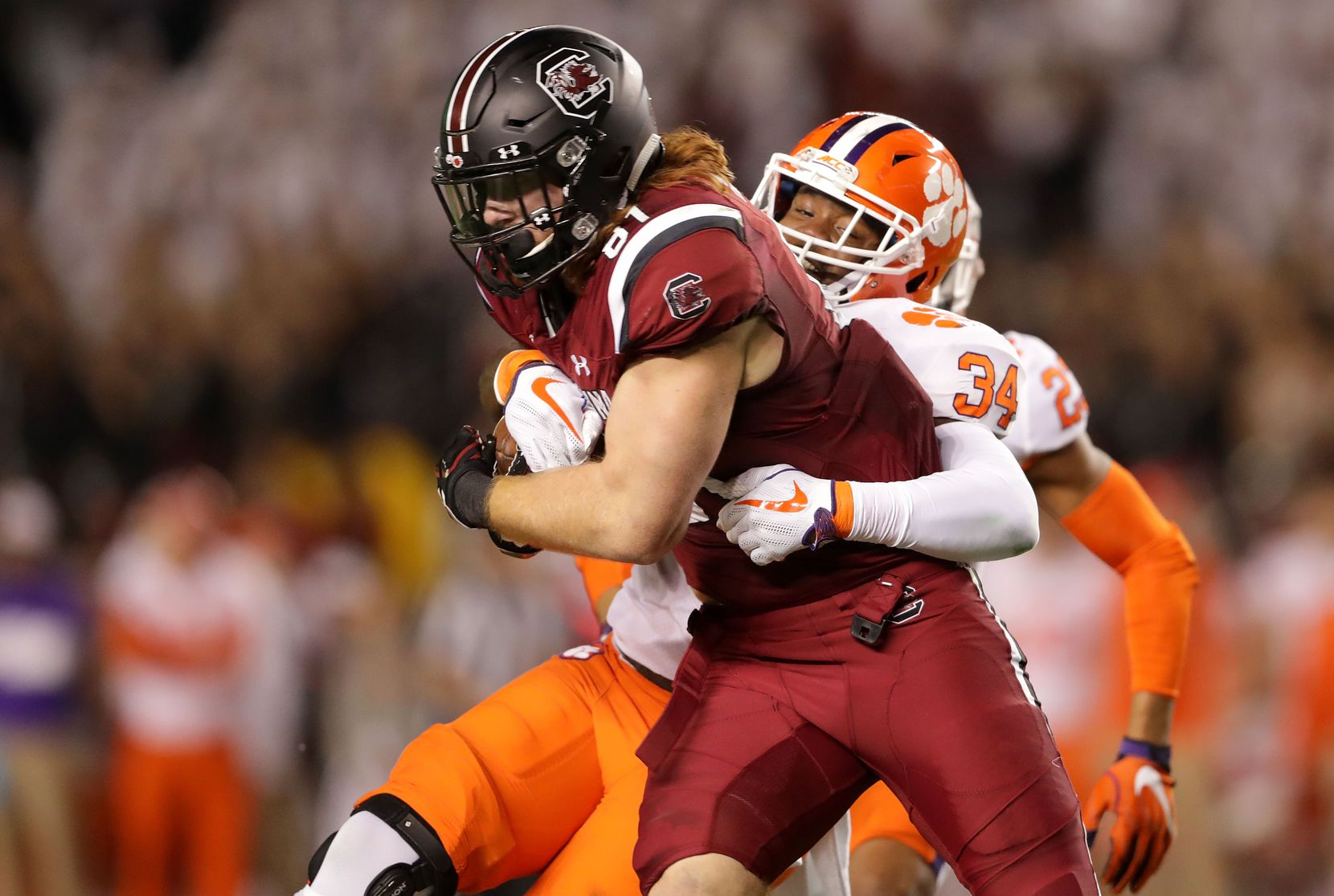 COLUMBIA, SC - NOVEMBER 25:  Kendall Joseph (#34) of the Clemson Tigers tries to stop Hayden Hurst (#81) of the South Carolina Gamecocks during their game at Williams-Brice Stadium on Nov. 25, 2017, in Columbia, S.C.  (Photo by Streeter Lecka/Getty Images)