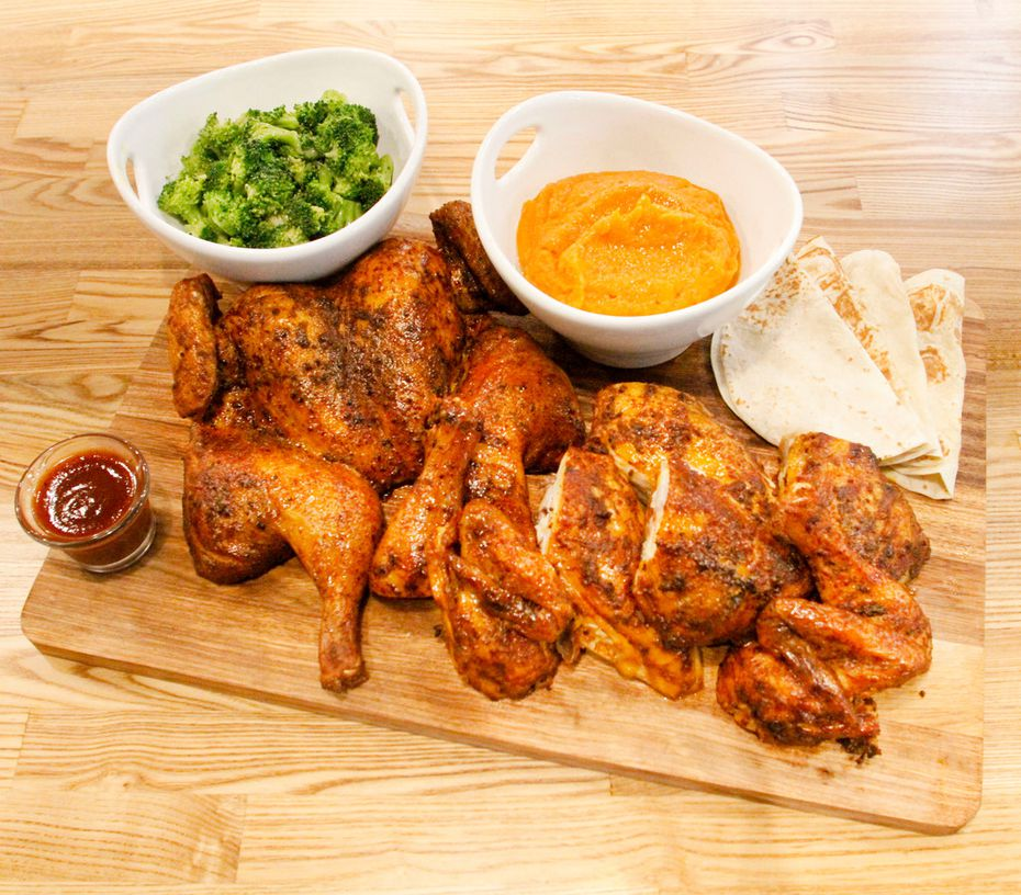 Smoked chicken (served here with broccoli, sweet potato mash and tortillas) is what gave Hickory Bird its name.