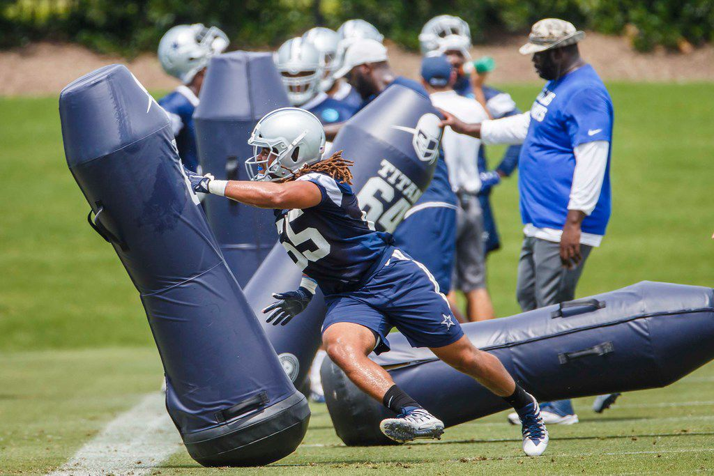 Dallas Cowboys defensive end Austin Larkin (65) runs a drill during the team's minicamp at The Star on Wednesday, June 13, 2018, in Frisco, Texas. (Smiley N. Pool/The Dallas Morning News)