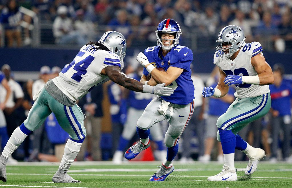 New York Giants quarterback Eli Manning (10) is hit hard and sacked by Dallas Cowboys linebacker Jaylon Smith (54) during the third quarter at AT&T Stadium in Arlington, Texas, Sunday, September 16, 2018. The Cowboys defeated the Giants, 20-13. (Tom Fox/The Dallas Morning News)