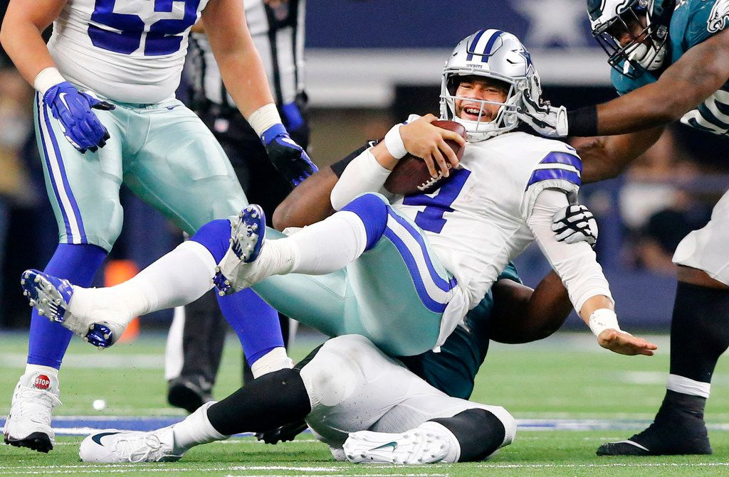 Dallas Cowboys quarterback Dak Prescott (4) is sacked in overtime by Philadelphia Eagles defensive tackle Fletcher Cox (91) at AT&T Stadium in Arlington, Texas, Sunday, December 9, 2018. The Cowboys won in overtime, 29-23. (Tom Fox/The Dallas Morning News)