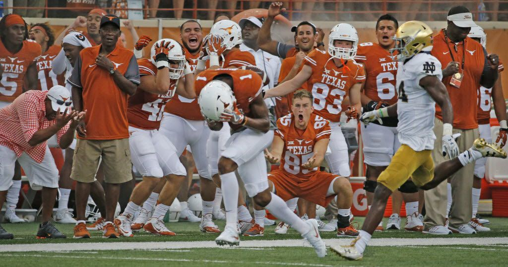The Longhorns bench reacts as Texas wide receiver John Burt (1) can't get a handle on a catchable long pass in the first quarter during the Notre Dame Fighting Irish vs. the University of Texas Longhorns NCAA football game at Darrell K. Royal Memorial Stadium in Austin on Sunday, September 4, 2016. (Louis DeLuca/The Dallas Morning News)