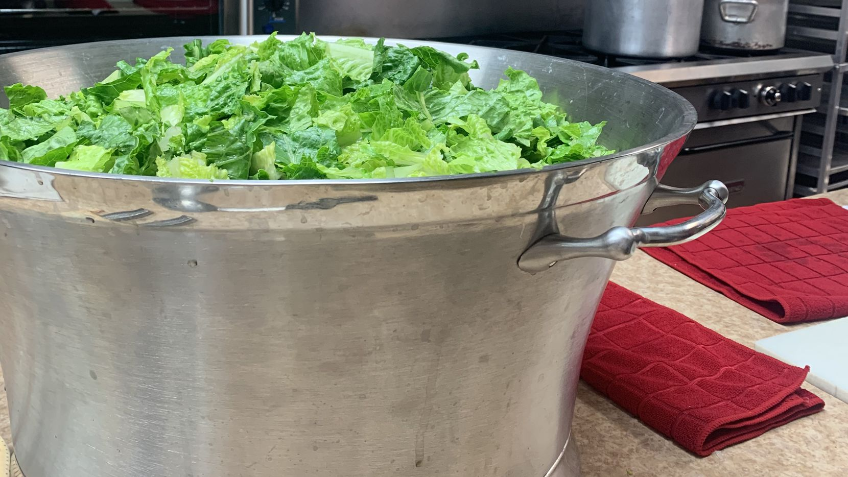A giant ice bucket is used to prepare Caesar salad for 200 guests at Acton United Methodist Church.