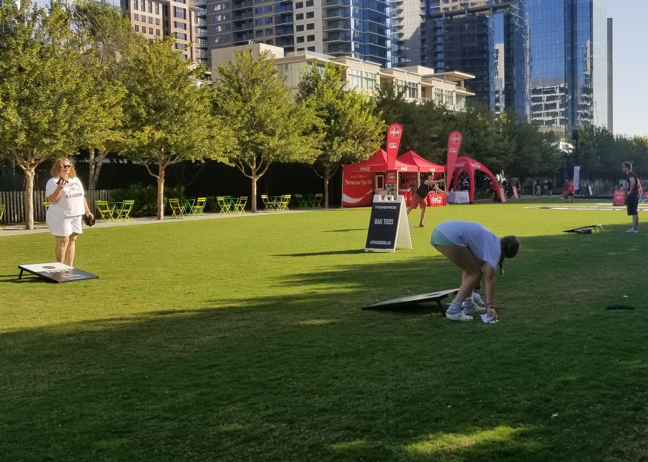 World Cup spectators play bean bag toss in Klyde Warren Park before the watch party, featuring the France vs. Croatia final match, began on Sunday July 15.