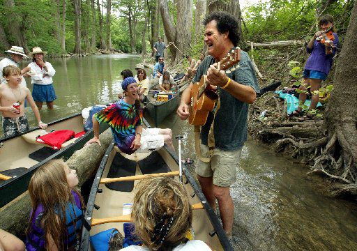 (Shot 5/24/02)    Bill Oliver on guitar and Beth Galiger on fiddle, both of Austin, serenade Kerrville Folk Festival-goers on the weekly canoe trip  up the Guadalupe River Friday morning.  The 18-day singer-songwriter music festival started Thursday the 23rd and runs until June 9th at Quiet Valley Ranch just outside Kerrville.