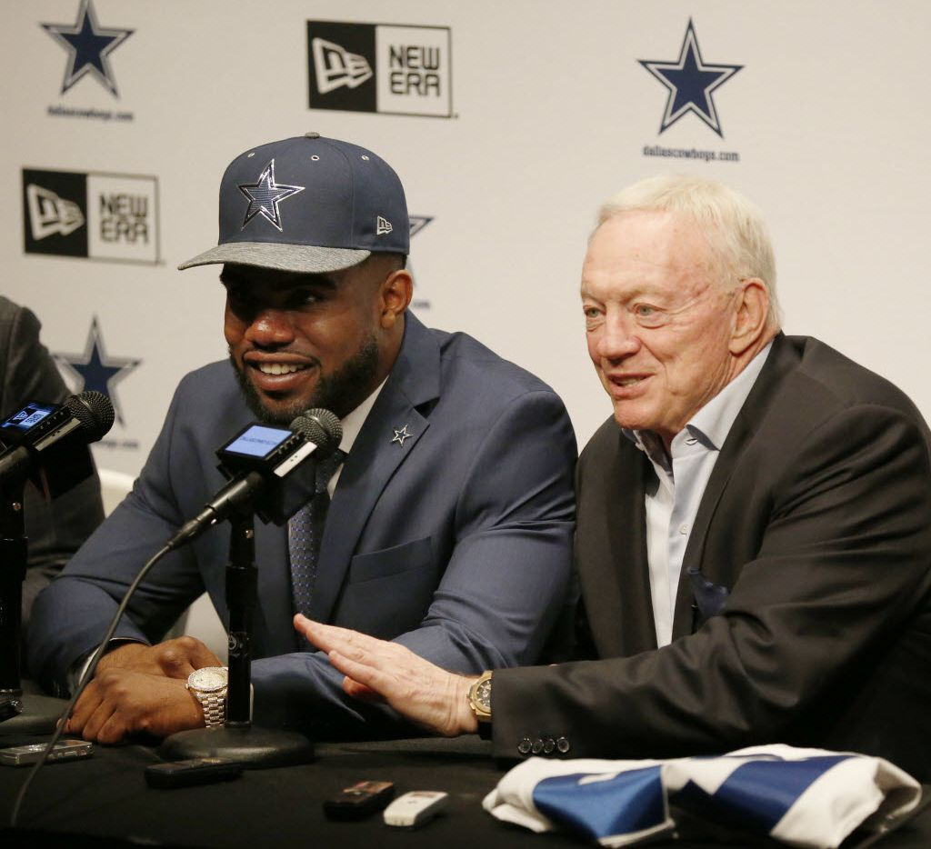 Running back Ezekiel Elliott (left), who played for Ohio State, is introduced by Dallas Cowboys owner Jerry Jones after being drafted fourth overall in the 2016 NFL draft by the Cowboys at the team's headquarters in Irving, Texas, Friday April 29, 2016. (Andy Jacobsohn/The Dallas Morning News)