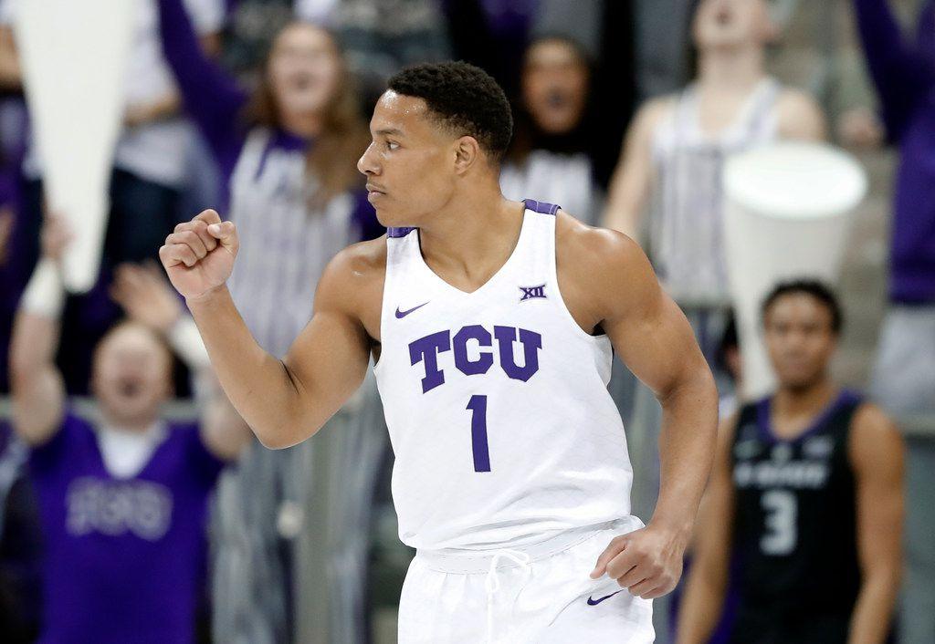 TCU guard Desmond Bane (1) celebrates sinking a three-point basket in the first half of an NCAA college basketball game against Kansas State in Fort Worth, Texas, Monday, March 4, 2019. (AP Photo/Tony Gutierrez)