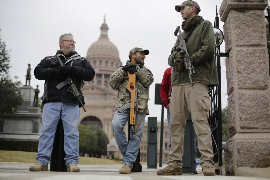 Gun rights advocates carry rifles while protesting outside the Texas Capitol on Jan. 13, 2015, in Austin, Texas. (AP Photo/Eric Gay)