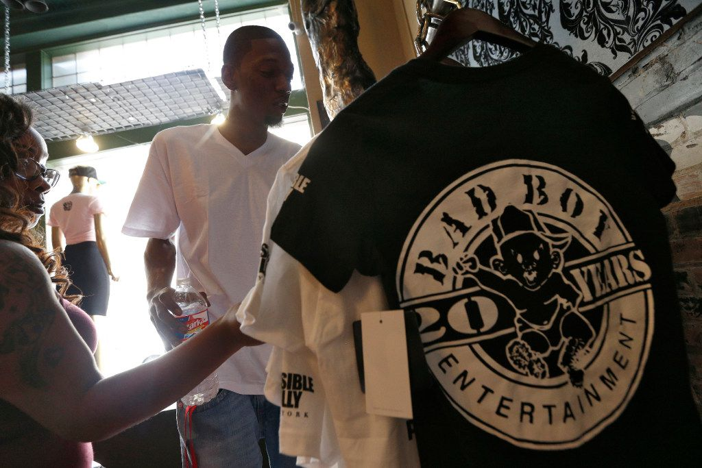 Archalle Williams and her husband Arthur Williams shop for Bad Boy shirts to wear to the concert at pop-up store featuring Bad Boy products at  Guns and Roses Boutique in Dallas, TX Sept. 14, 2016.
