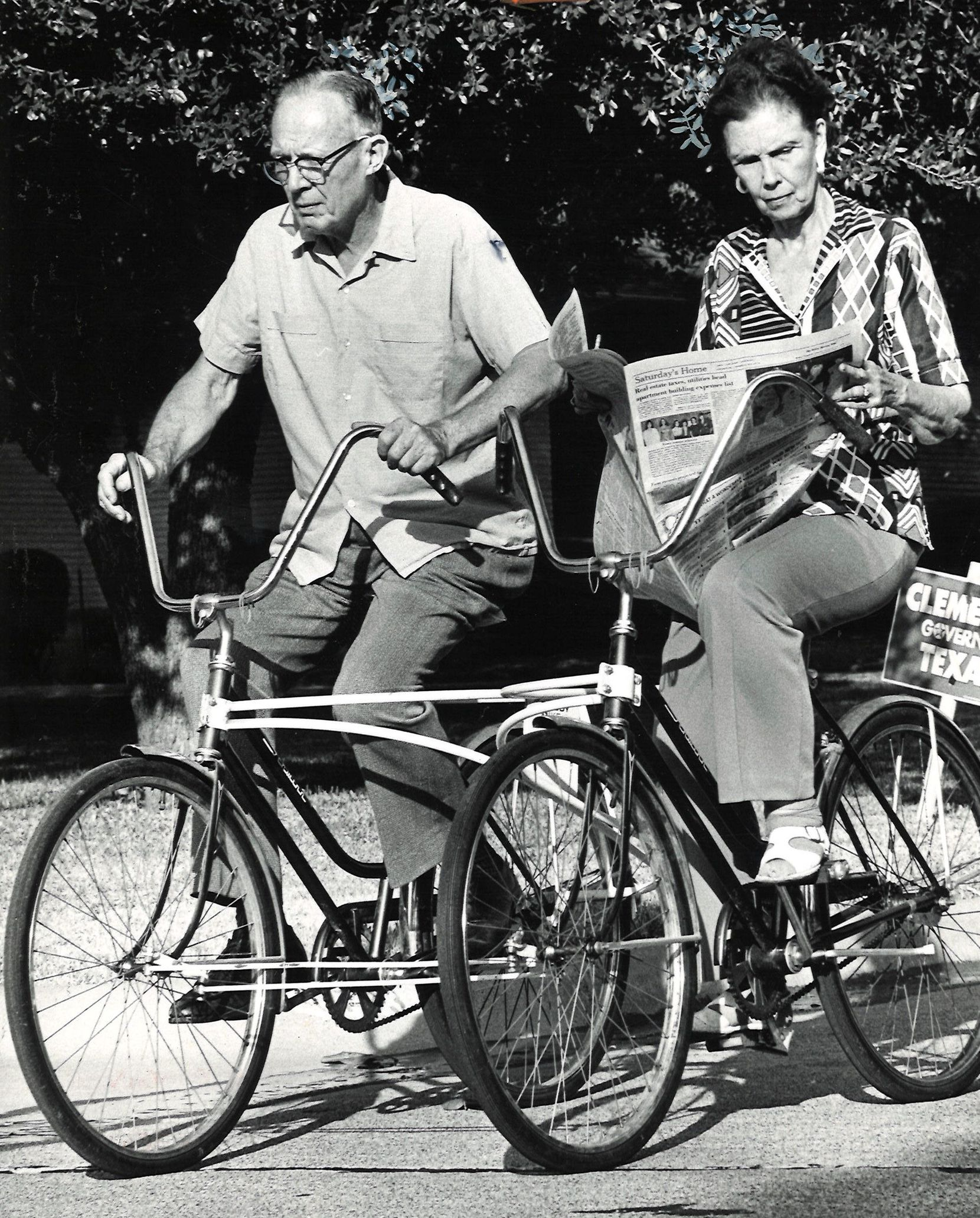 """Oct. 26, 1978: Mr. and Mrs. M.T. Green, both in their 70s, take an exercise ride on their """"Buddy-Bike."""" The partners can both pedal, or one can relax and do the crossword puzzles while the other carries the load."""