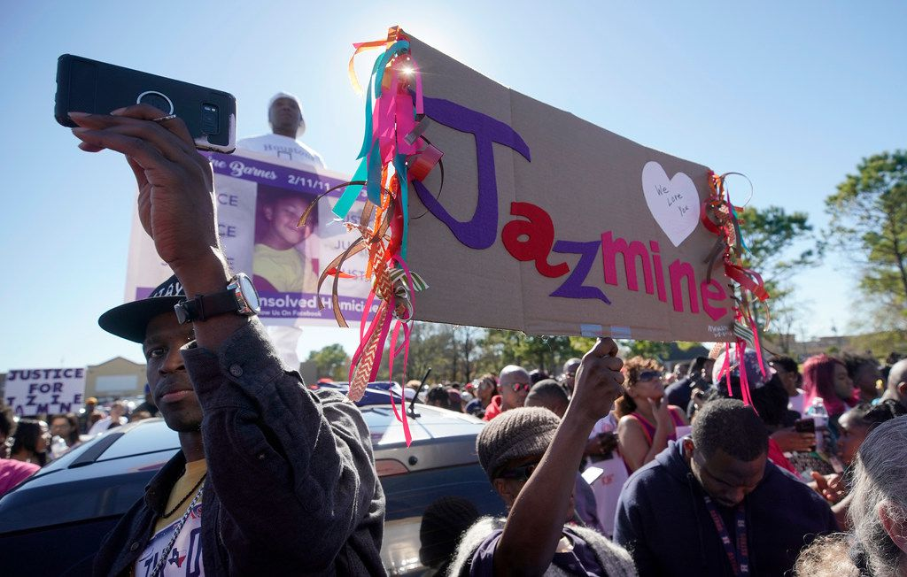 People attend a community rally outside a Walmart on East Sam Houston Pkwy N in Houston on Saturday, Jan. 5, 2019 for 7-year-old Jazmine Barnes, who was killed on Sunday. Jazmine was shot to death nearby while riding in a car with her mother and three sisters. (Melissa Phillip/Houston Chronicle via AP)
