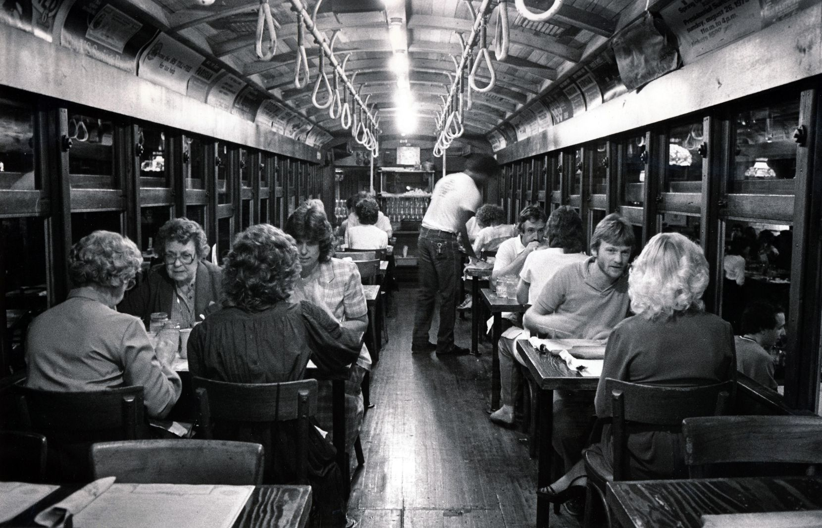 Diners eat inside the trolley at the Spaghetti Warehouse in Dallas' West End.