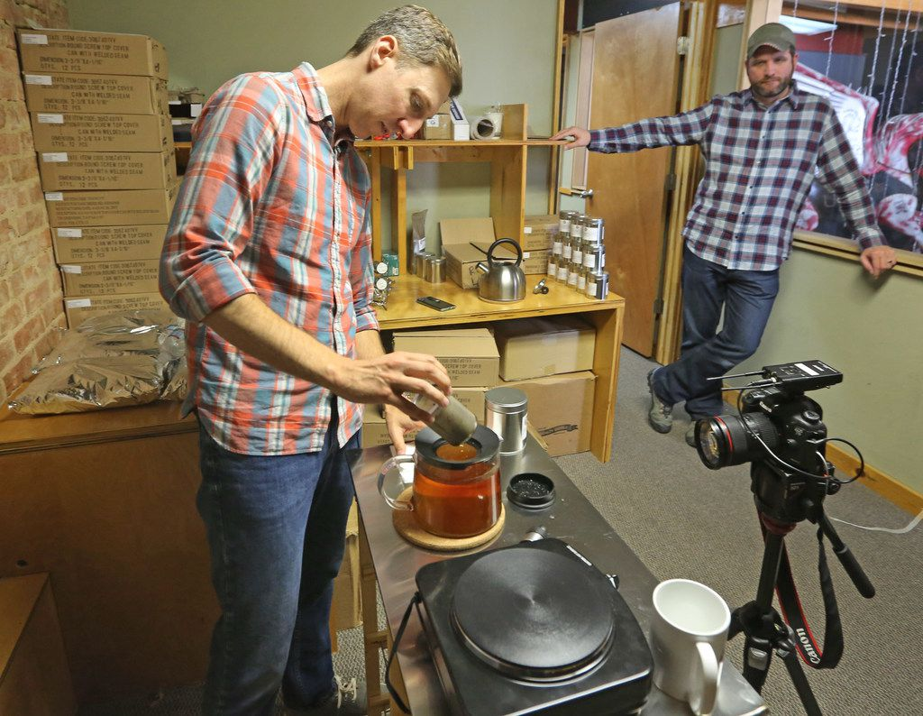 Brandon Friedman, left, and Terrence Kamauf make tea at the offices of Rakkasan Tea Company in Deep Ellum. Rakkasan is derived from the Japanese word for parachute, and is the nickname of their regiment within the U.S. Army's 101st Airborne Division.