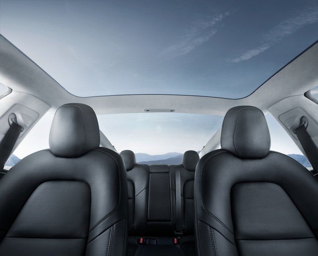 The Tesla Model 3's glass roof gives the interior an airy feel.