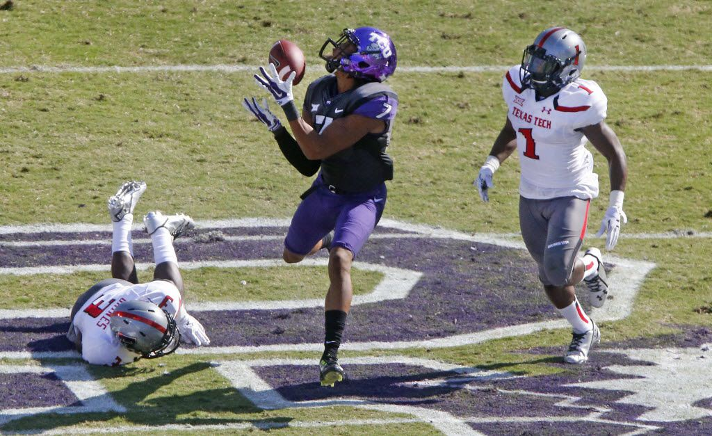 FILE - TCU receiver Kolby Listenbee (7) catches a long first-quarter pass between Texas Tech defenders Nigel Bethel II and J.J. Gaines (3) during the Texas Tech University Red Raiders vs. the TCU Horned Frogs college football game at Amon G. Carter Stadium in Fort Worth on Saturday, October 25, 2014.  (Louis DeLuca/The Dallas Morning News)