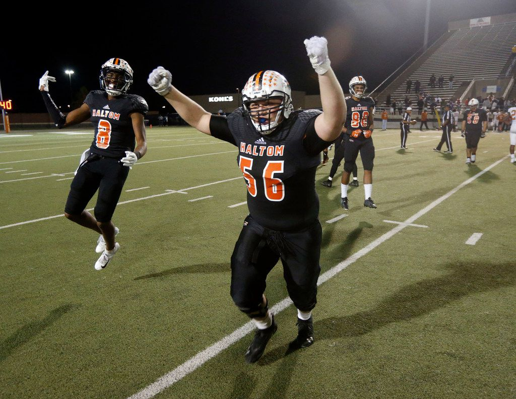 Haltom's Julian Johnson (8) and Mikel Estrello (56) celebrate their victory over Arlington Bowie after their Class 6A Division II first-round playoff football game in North Richland Hills on Nov. 16, 2018. Haltom won 47-41.(Michael Ainsworth/Special Contributor)