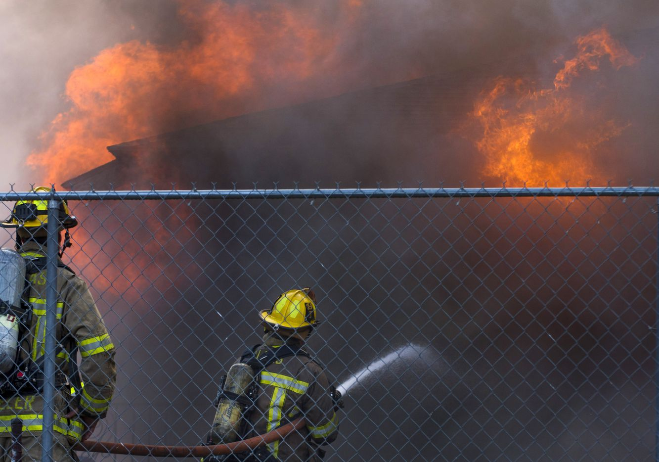 An empty apartment building caught fire in the 800 block of Ewing Avenue near Colorado Boulevard on Tuesday. The fire spread to a nearby building where eight residents were displaced.