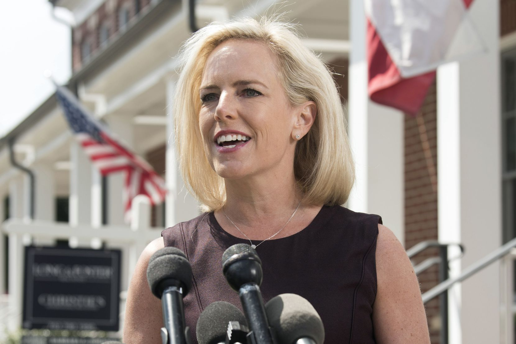 Homeland Security Secretary Kirstjen Nielsen talks outside her home in Alexandria, Va., on Thursday, April 8, 2019. Nielsen says she continues to support the president's goal of securing the border in her first public remarks since her surprise resignation.