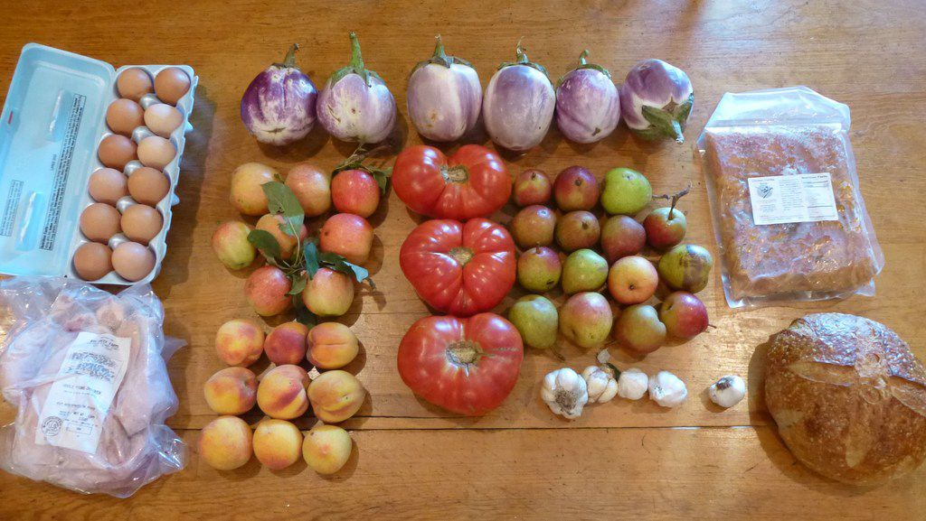 Here's the bounty I brought home from the Cowtown Farmers Market last Saturday: eggplant, apples, pears, peaches, tomatoes, garlic, pastured chicken and eggs, chicken tortilla soup (the frozen rectangle, upper right) and just below it, sourdough bread made fresh that morning.