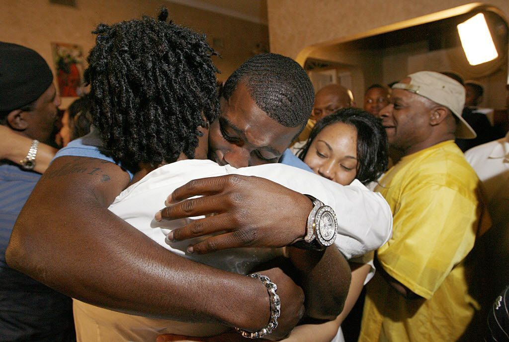 Wide receiver Dez Bryant, center, hugs his mother, Angie Bryant, after being selected as the  24th overall pick by the Dallas Cowboys in the first round of  NFL Draft, Thursday, April 22, 2010 in DeSoto, Texas.