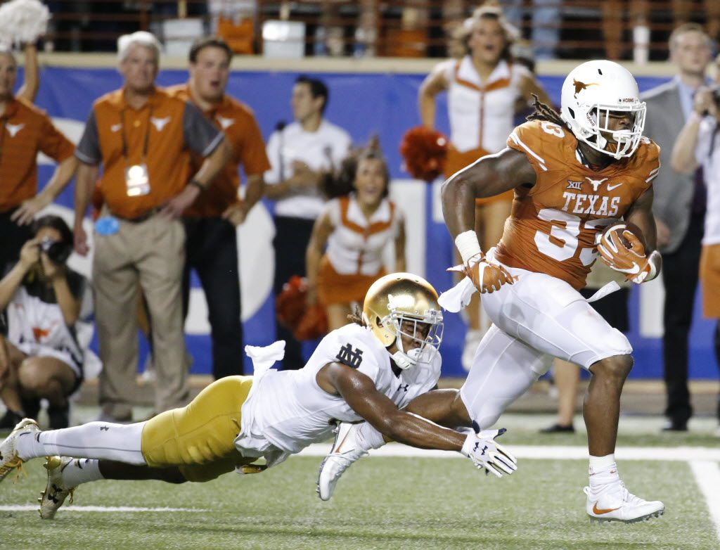 Texas running back D'Onta Foreman (33) breaks free on a long touchdown run in the fourth quarter during the Notre Dame Fighting Irish vs. the University of Texas Longhorns NCAA football game at Darrell K. Royal Memorial Stadium in Austin on Sunday, September 4, 2016. (Louis DeLuca/The Dallas Morning News)