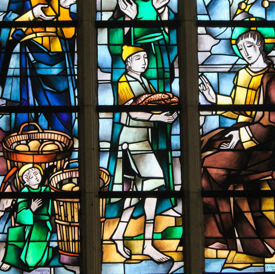 Stained glass in the Church of Tervuren, Belgium, depicts the Gospel account of feeding the multitude.