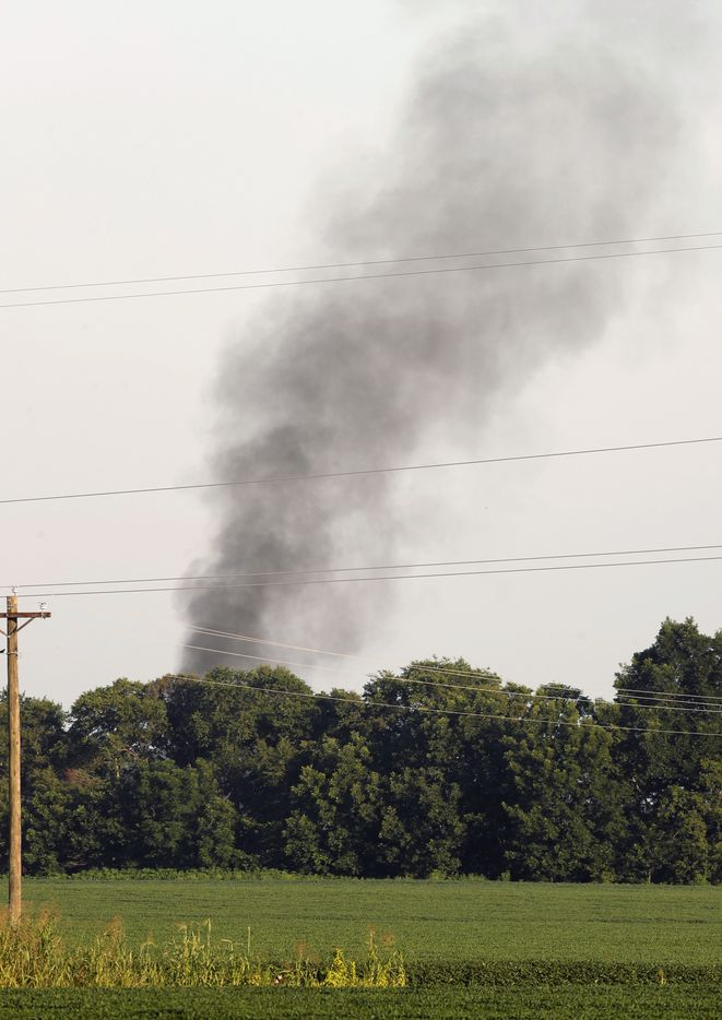 Smoke rose in the air after a military transport plane crashed into a field on Monday near Itta Bena, Miss., about 85 miles north of Jackson. Officials have not released information on what caused the crash or where the flight originated.