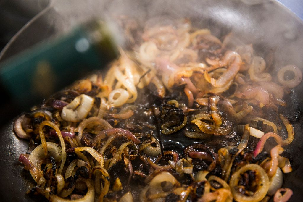 Caramelized onions are doused with balsamic vinegar.