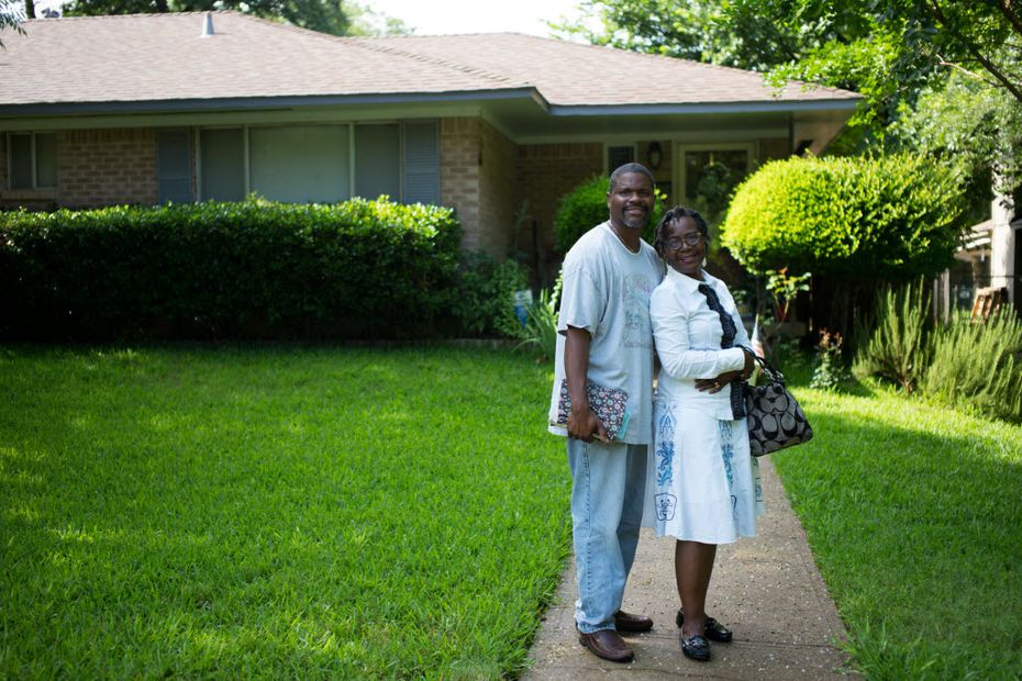 Roddie Thomas (left), and Patrice Thomas, both of Kiestwood poses for a portrait in front of their residence in the Kiestwood neighborhoodon June 11, 2016 in Dallas. (Ting Shen/The Dallas Morning News)