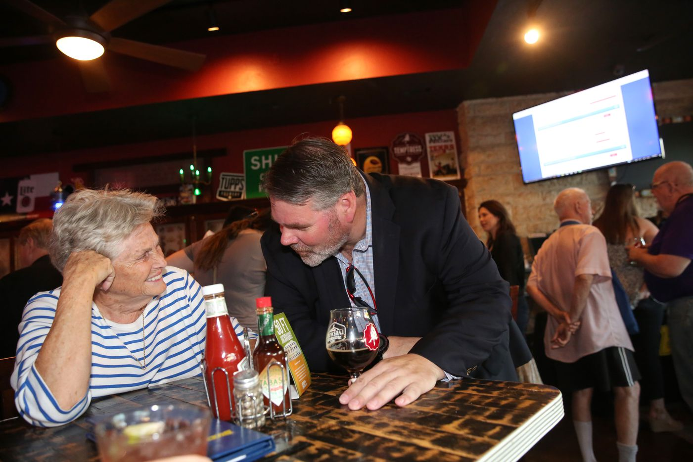 Dallas district 14 city council  candidate Matt Wood talks to former State Rep. Harryette Ehrhardt during an election watch party at Buzzbrews in Dallas on Saturday, May 6, 2017. Wood is running against incumbent Philip T. Kingston and Kim Welch.