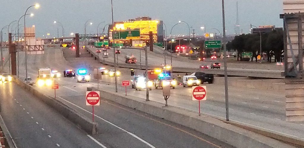 The scene of the wreck in the 3200 block of LBJ Freeway, on the south side of the road, early Sunday.