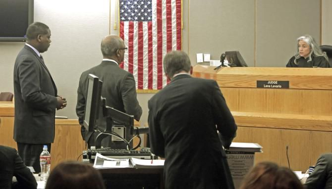 Dallas County District Attorney Craig Watkins (far left) was before state District Judge Lena Levario on March 7, 2013.