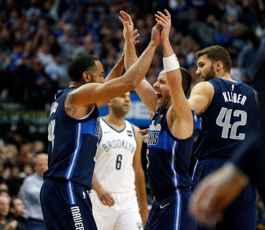 Mavericks guard  Devin Harris, celebrating with J.J. Barea, had his best game of the season Wednesday. He and J.J. Barea led a strong effort by the bench brigade.  (AP Photo/Michael Ainsworth)