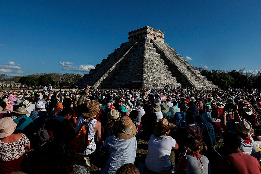 People surround the El Castillo pyramid at the Mayan archaeological site of Chichen Itza in the Mexican state of Yucatan.