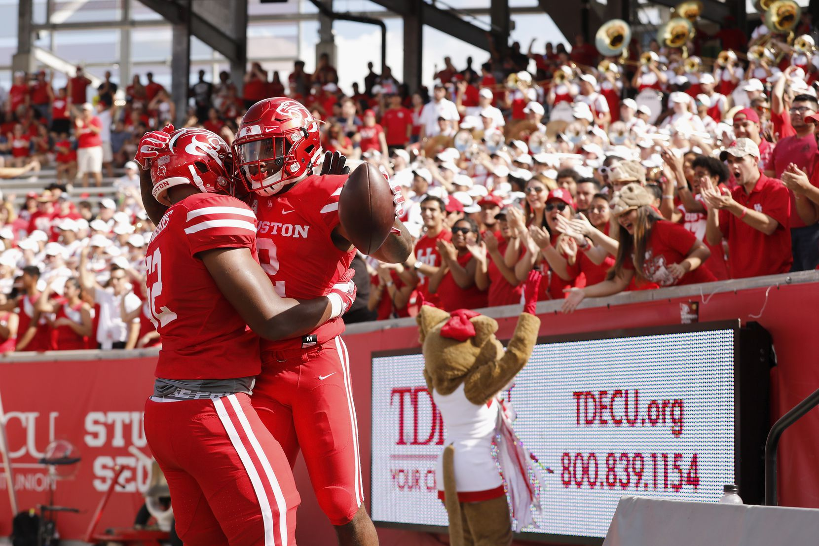 HOUSTON, TX - NOV. 04, 2017:  Jarrid Williams #62 of the Houston Cougars celebrates with Duke Catalon #2 after touchdown in the first half at TDECU Stadium on November 4, 2017 in Houston, Texas.  (Photo by Tim Warner/Getty Images)