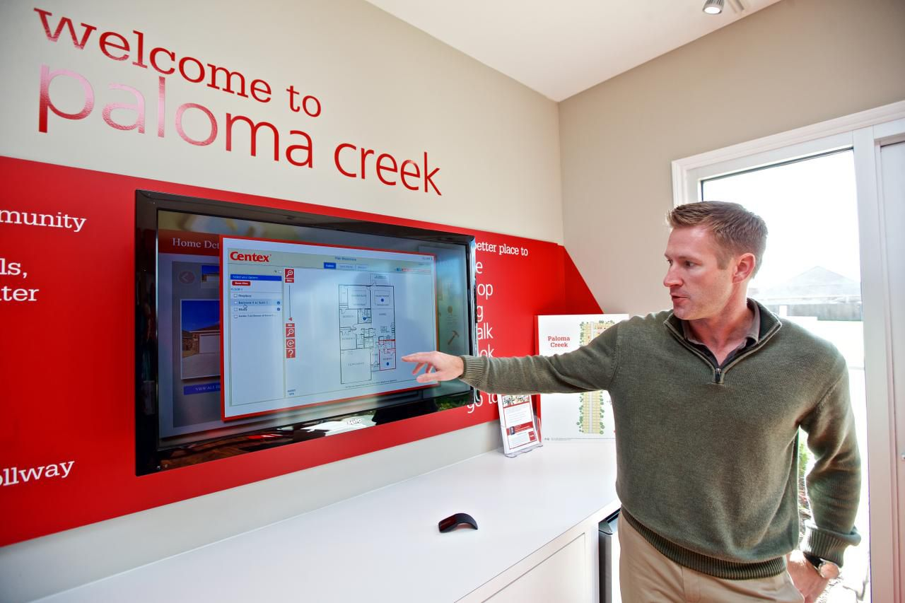 """Centex Plute Homes General Sales Manager Mike Goza points out the floor plan of the """"Brookmere"""" currently available in the Paloma Creek South neighborhood in Little Elm, Friday, November 6, 2015. The Brookmere currently sales for $195,990."""