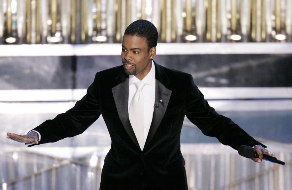 Chris Rock performs his monologue to open the 77th Academy Awards telecast in Los Angeles.