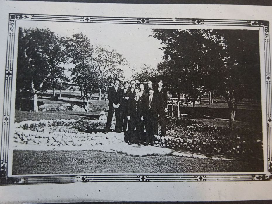 A Sunday school group poses at Finch Park in the 1940s with the band stand in the background behind the tree.