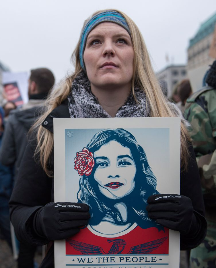 Women and men attend a protest for women's rights and freedom in solidarity with the Women's March on Washington in front of Brandenburger Tor on January 21, 2017 in Berlin, Germany.
