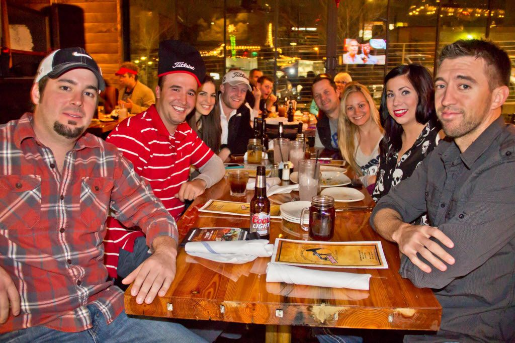 A group of friends hang out at The Nodding Donkey on SMU Boulevard in Dallas in 2012.