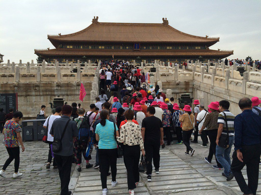 Long lines of tourists stream into one of the buildings at the Forbidden City in Beijing, China, in September 2017.