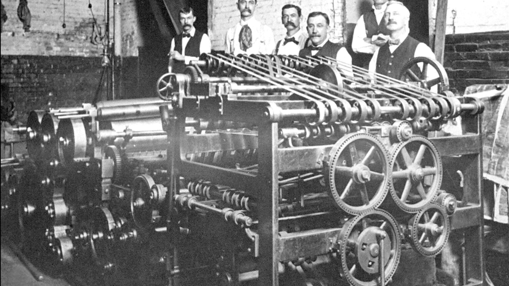 This Bullock press put out the first issue of The News in 1885.  G.B. Dealey is at the far right.