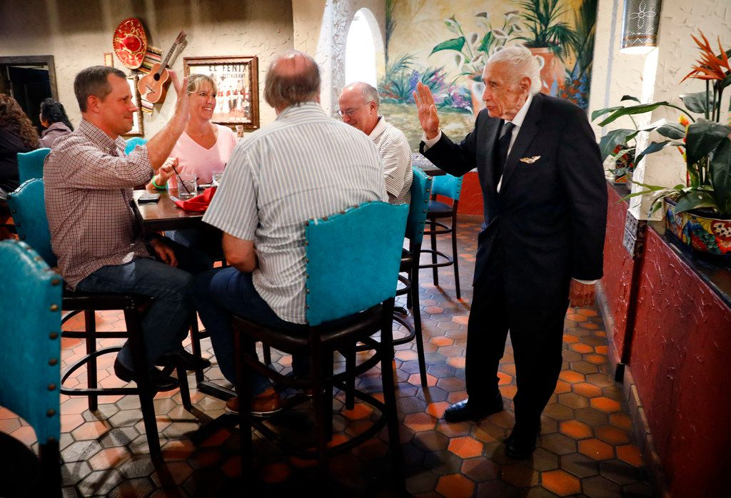 Alfred Martinez (right), son of original owner Miguel Martinez, stops to say hello to patrons (from left) Mike Talkington, Mary Reeder and Chuck Lehockey at restaurant No. 1 along Woodall Rodgers Freeway.