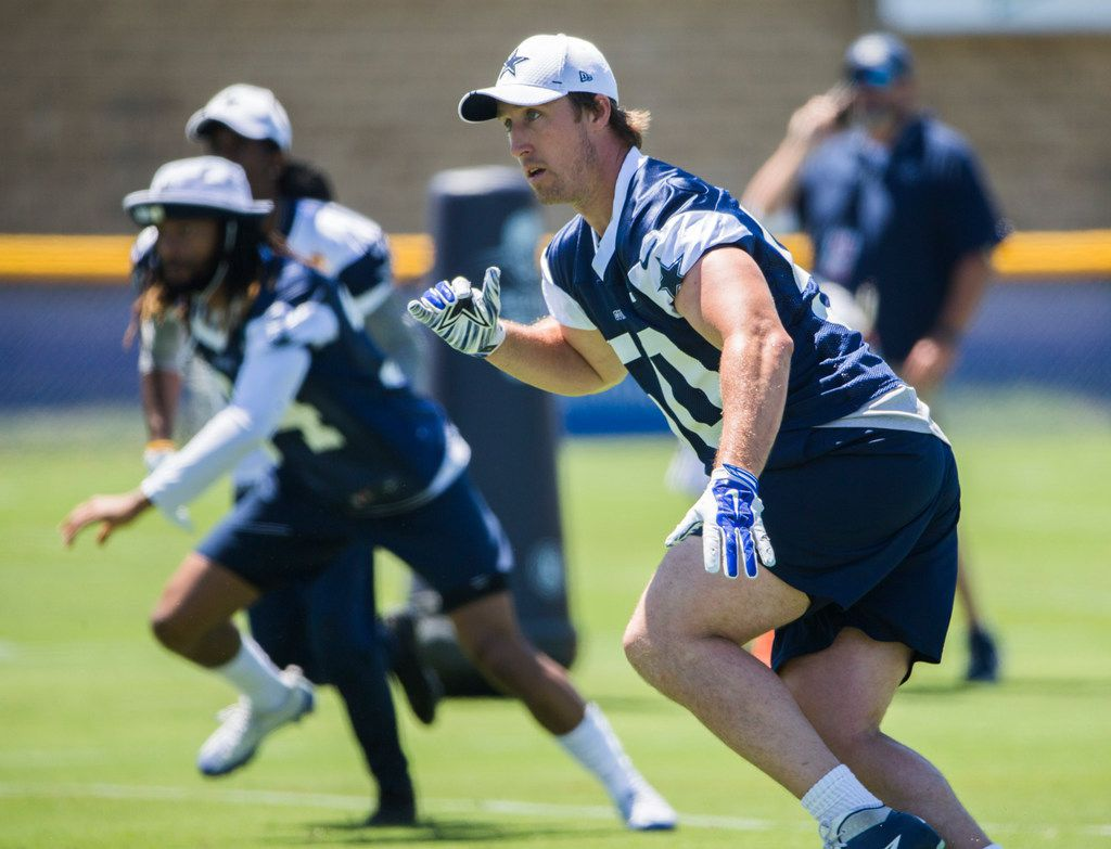 Dallas Cowboys outside linebacker Sean Lee (50) runs a play during a morning walk through practice at training camp in Oxnard, California on Saturday, July 27, 2019. (Ashley Landis/The Dallas Morning News)