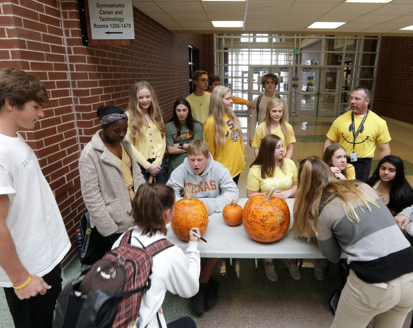 In addition to seeking out at-risk students, Hope Squad members, who often wear yellow — the color for suicide  prevention — promote a more caring culture throughout Prosper High School. Last week they encouraged students during their lunch break to sign pumpkins with their names and a phrase telling others what they are most thankful for.