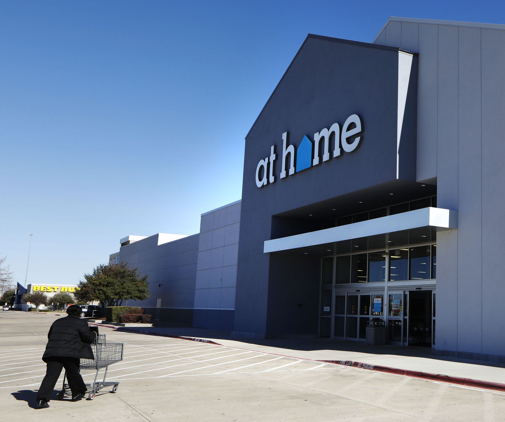 A shopper walks towards an At Home store in Plano.