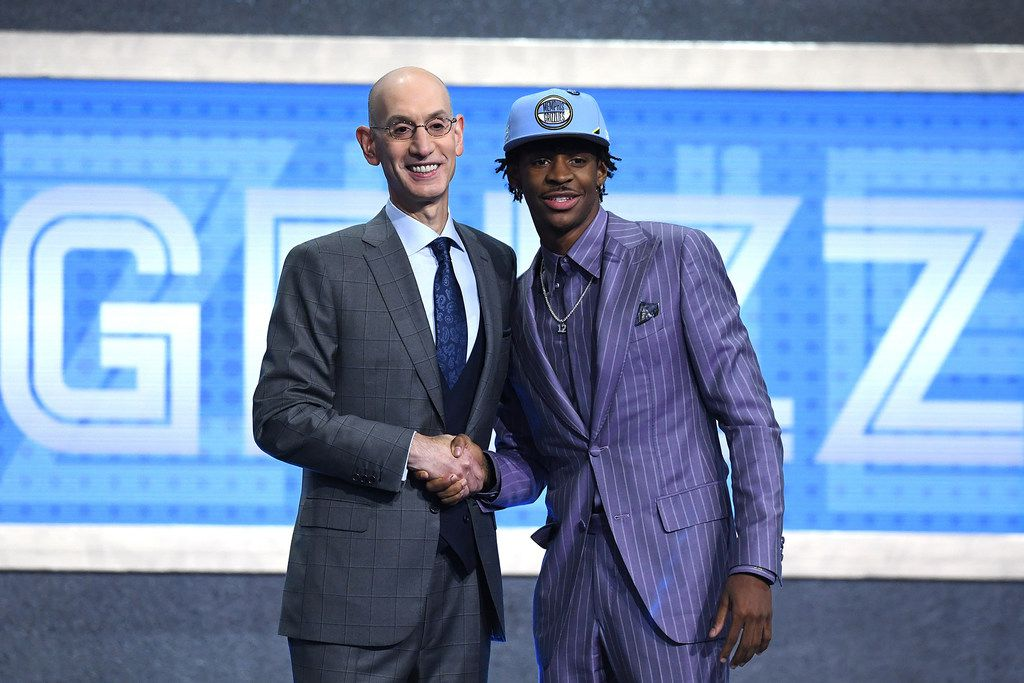 Ja Morant poses with NBA Commissioner Adam Silver after being drafted with the second overall pick by the Memphis Grizzlies during the NBA Draft at the Barclays Center in New York on Thursday, June 20, 2019. (Sarah Stier/Getty Images/TNS) **FOR USE WITH THIS STORY ONLY**